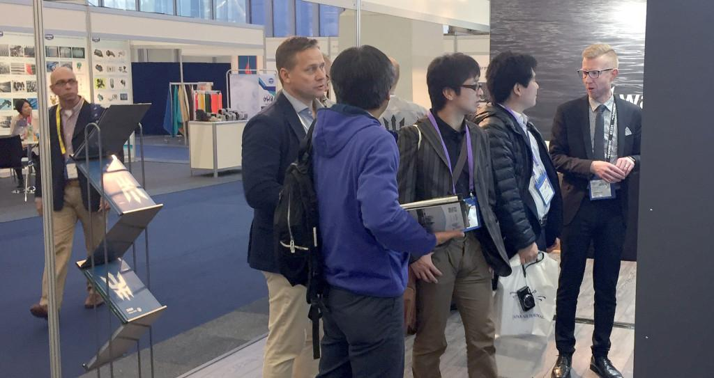 Niklas Öhman and Ville Keskilohko introducing Q system's new features to visitors